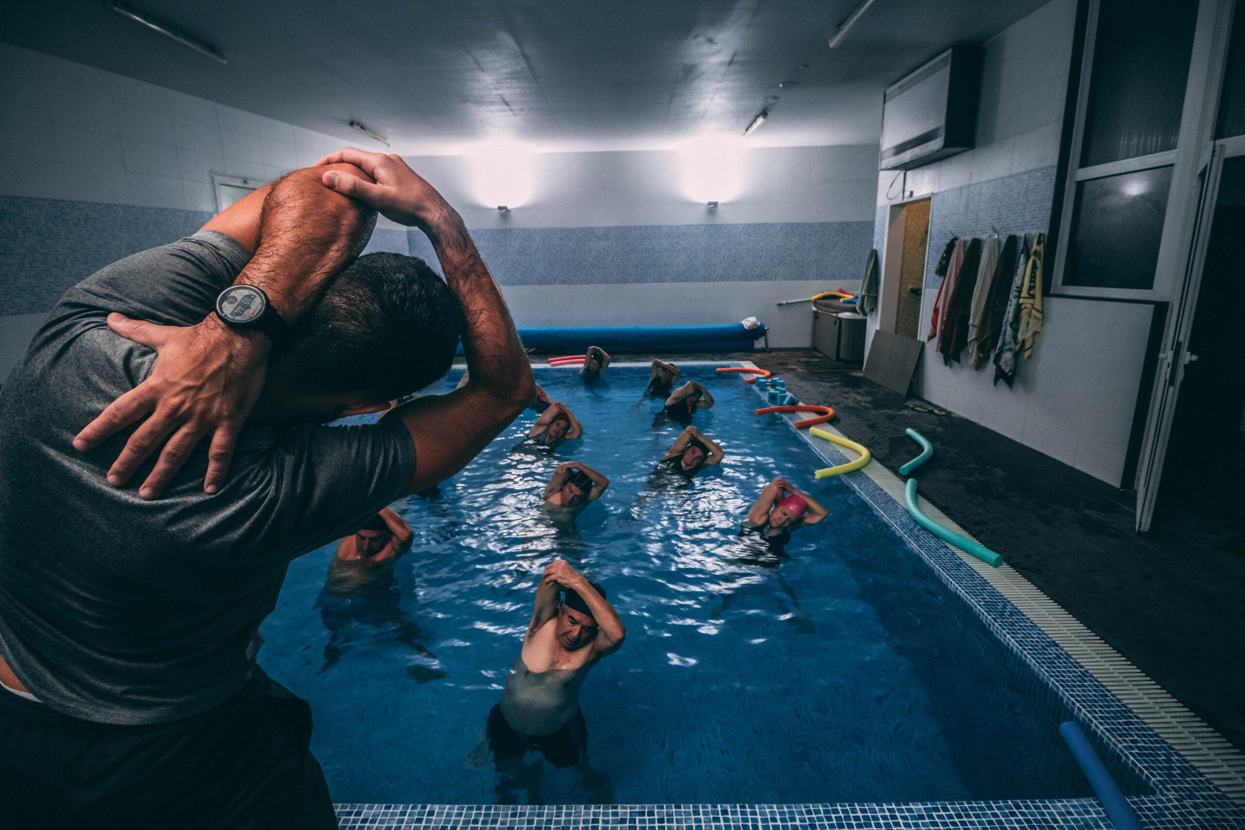 people stretching inside pool room